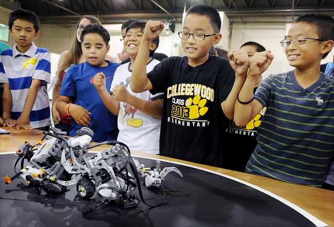 Collegewood Elementary students cheer on their robot at Robot Expo.