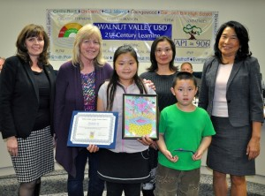 Evergreen Elementary student Michelle Xu joins family members, Board President Cindy Ruiz, Principal Carolyn Wills and teacher Cathy Patterson.