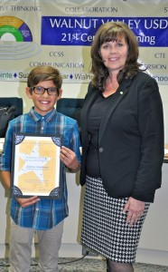 Walnut Elementary 5th grader Andrew Zambrano with Walnut Valley Board President Cindy Ruiz.