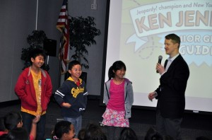 Walnut Elementary students Jeremy Cai, Daisie Leng and Jimmy Wu played Jeopardy! with Ken Jennings, the game's biggest winner of all time.  Photo by Kelli Gile