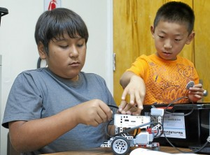 Luis Dominguz ,11, and Henry Lee, 9, build a robot at Villacorta Elementary School in La Puente