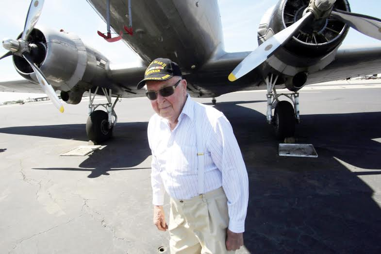 Gary Olson, 97, a World War II Navy Veteran from Reno, Nevada, gets a close look of a DC3 from the 1940's, as it's parked on the airstrip of the Cable Airport, reminiscing the times when he would fly out of this airport in the 1950's, during a visit of the Cable Airport in Upland, CA., Tuesday, April 19, 2016. Gary Olson has been flying most of his life and had a commercial pilots license up to his 95th birthday, he also knew Dewey Cable, the founder of the Cable Airport. (Photo by James Carbone for the Inland Valley Daily Bulletin)