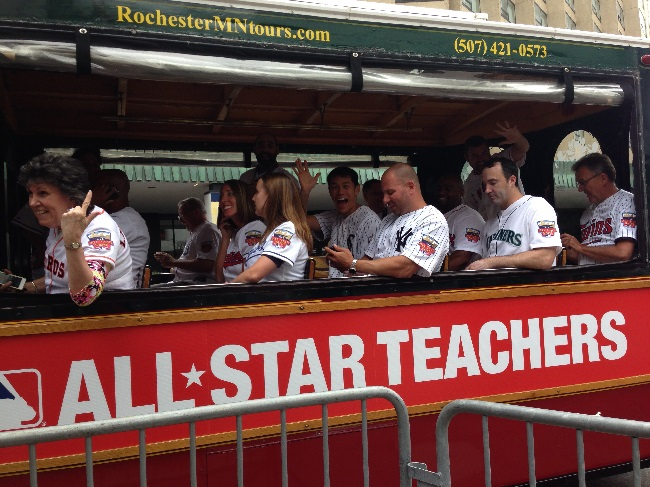 Walnut High teacher Garrett Lim waves from All-Star Teachers trolley in All-Star parade.