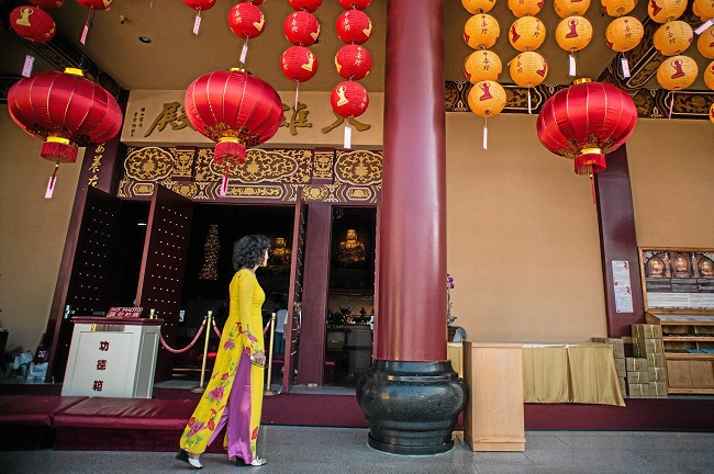 Dressed in traditional Vietnamese clothing Anh Phan, of Garden Grove, visits the Hsi Lai Temple in Hacienda Heights on Tuesday, February 17, 2015 which is decorated for the upcoming Lunar New Year's celebration. (Photo by Sarah Reingewirtz)