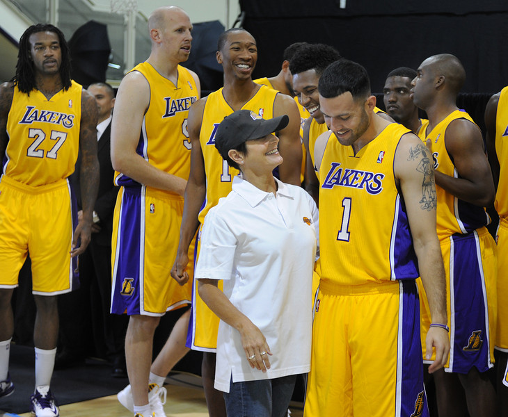 Lisa Estrada, Director of Game Operations and Entertainment says hello to Nick Young and Jordan Farmar as they enter the practice facility for media day. The Los Angeles Lakers held a media day at their El Segundo practice facility. Players were photographed for team materials, and interviewed by the press. El Segundo, CA. 9/27/2013. photo by (John McCoy/Los Angeles Daily News)