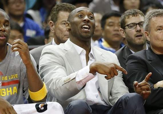 Kobe Bryant of the Los Angeles Lakers talks to his team players during a 2013-2014 NBA preseason game between Los Angeles Lakers and Golden State Warriors at Mercedes-Benz Arena in Shanghai, China, Friday, Oct. 18, 2013. (AP Photo/Eugene Hoshiko)