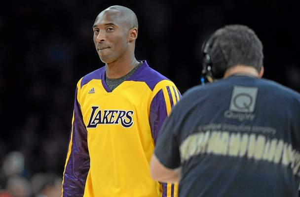 The Lakers' Kobe Bryant makes an appearance at Staples Center on Nov. 15, 2013, during the team's game against the Memphis Grizzlies, to present a check for victims of Typhoon Haiyan in the Philippines. (Photo by Hans Gutknecht/Los Angeles Daily News)