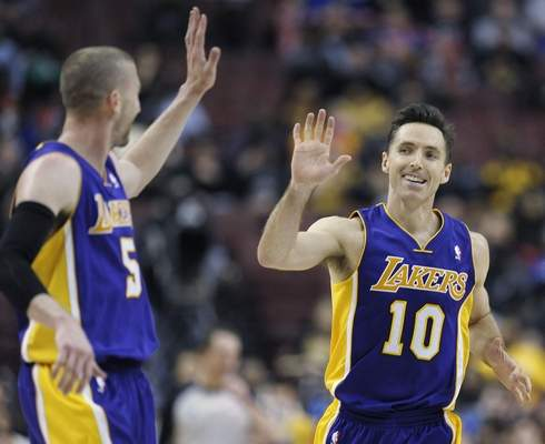 Michael Perez–The Associated Press The Lakers' Steve Nash, right, celebrates with Steve Blake during a recent victory.