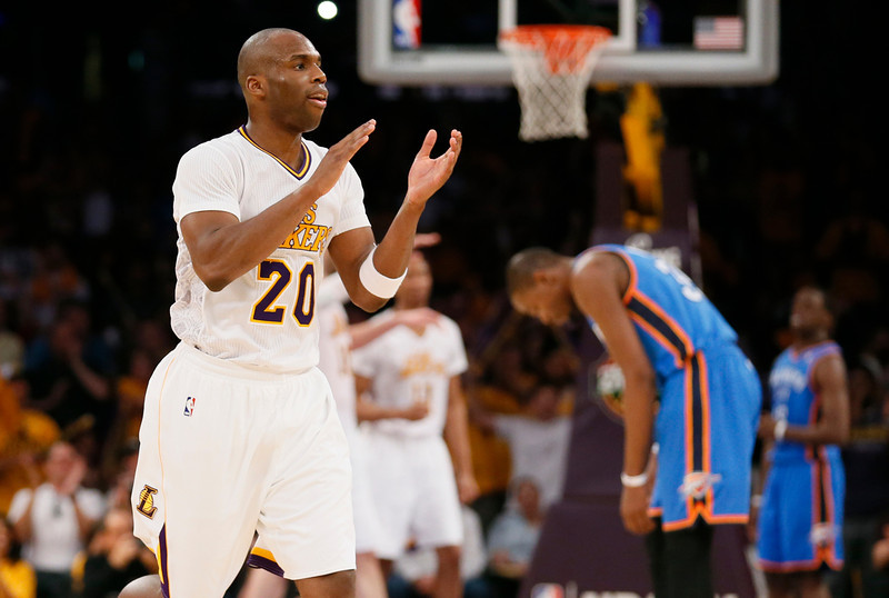 Los Angeles Lakers shooting guard Jodie Meeks, left, celebrates late in the fourth quarter as Oklahoma City Thunder small forward Kevin Durant, right, reaxts during an NBA basketball game in Los Angeles, Sunday, March 9, 2014. The Lakers won 114-110. (AP Photo/Danny Moloshok)