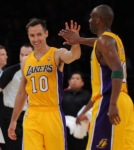 Lakers#10 Steve Nash gets a high five from Lakers#20 Jodie Meeks after making his 4th assist on the night. The Houston Rockets traveled to Los Angeles to play the Lakers in a regular season game at Staples Center. Los Angeles, CA. April 8, 2014 (Photo by John McCoy / Los Angeles Daily News)