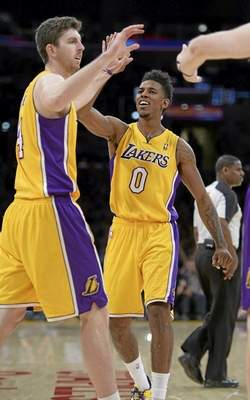 The Lakers' Ryan Kelly and Nick Young celebrate a shot late in the 4th quarter The Cleveland Cavaliers defeated the Lakers 120 to 118 in a regular season NBA game at Staples Center. Los Angeles, CA January 14, 2014.(John McCoy/Los Angeles Daily News)