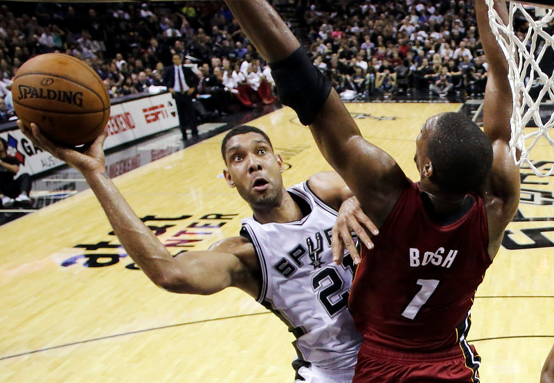 San Antonio Spurs forward Tim Duncan (21) shoots over Miami Heat center Chris Bosh (1) during the first half in Game 1 of the NBA basketball finals on Thursday, June 5, 2014, in San Antonio. (AP Photo/Eric Gay, Pool)