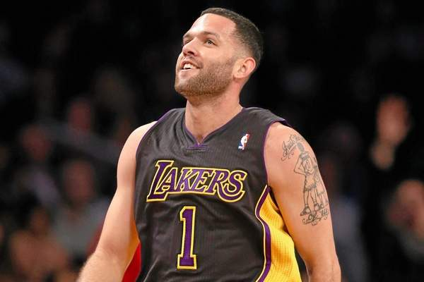 Los Angeles Lakers point guard Jordan Farmar (1) reacts after scoring in the second quarter of an NBA basketball game against the Brooklyn Nets at the Barclays Center, Wednesday, Nov. 27, 2013, in New York. (AP Photo/John Minchillo)