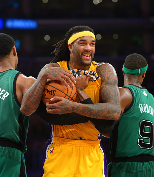 The Lakers' Jordan Hill smiles after securing a rebound before a timeout and the lead against the Celtics, Friday, February 21, 2014, at Staples Center. (Photo by Michael Owen Baker/L.A. Daily News)