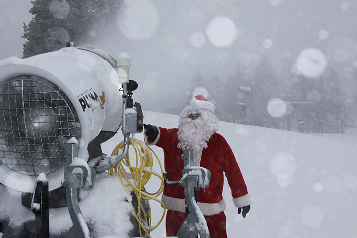 Santa offers a helping hand to the snow-making crew at Mountain High. (Mountain High photo)
