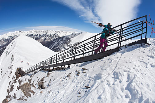 Skier hikes Gold Hill Stairs at Telluride. Photo by Ben Eng