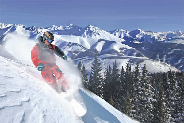 A skier takes on big powder at Crested Butte. (Crested Butte Mountain Resort photo)