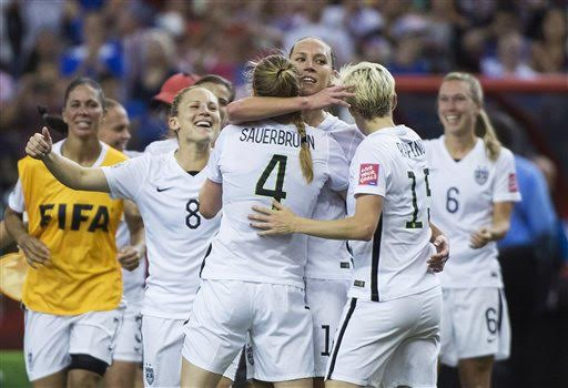 The U.S. team celebrates after defeating Germany 2-0 in a semifinal in the Women's World Cup soccer tournament, Tuesday, June 30, 2015, in Montreal, Canada. (Graham Hughes/The Canadian Press via AP)
