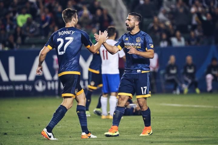 Dave Romney (left) and Sebastian Lletget celebrate the would-be game-winning goal against La Maquina on Tuesday that came in controversial fashion. (Photo by Stephanie Romero and Jon Lorentz // LA Galaxy)