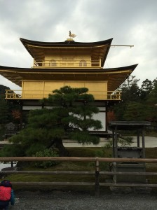 Side view of the Golden Pavilion, whose upper two floors are covered in gold leaf and is topped by a gold Phoenix. The building was rebuilt after a fire in the 1950s.