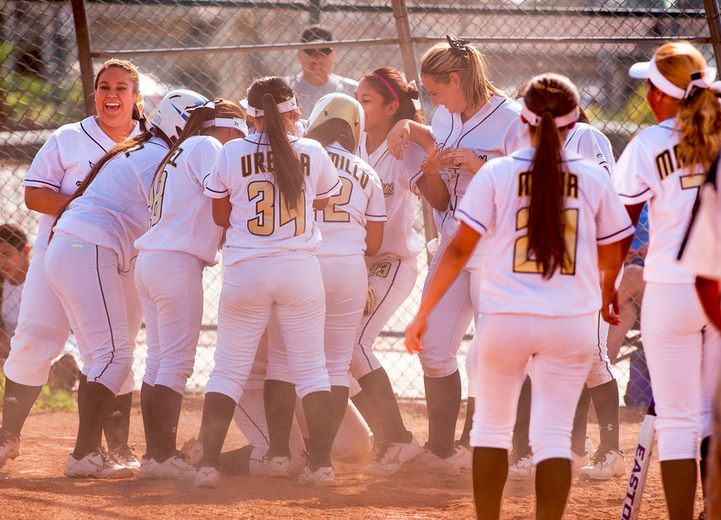 Northview High players swarm over Monet Manning after her game winning home run in the bottom of the seventh inning vs Barstow High at their Covina campus field May 19, 2014. (Staff photo by Leo Jarzomb/San Gabriel Valley Tribune)