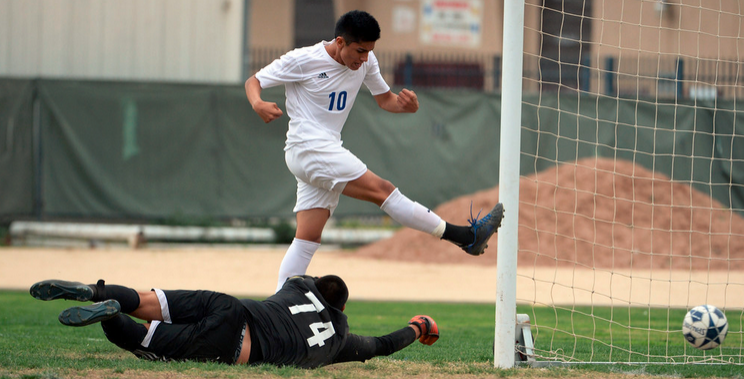 El Monte's Jesus Garcia, top, scores past Mountain View goal keeper Michael Garcia (74) in the first half of a prep soccer match at South El Monte High School in El Monte, Calif., on Thursday, January 29, 2015. (Photo by Keith Birmingham/ Pasadena Star-News)