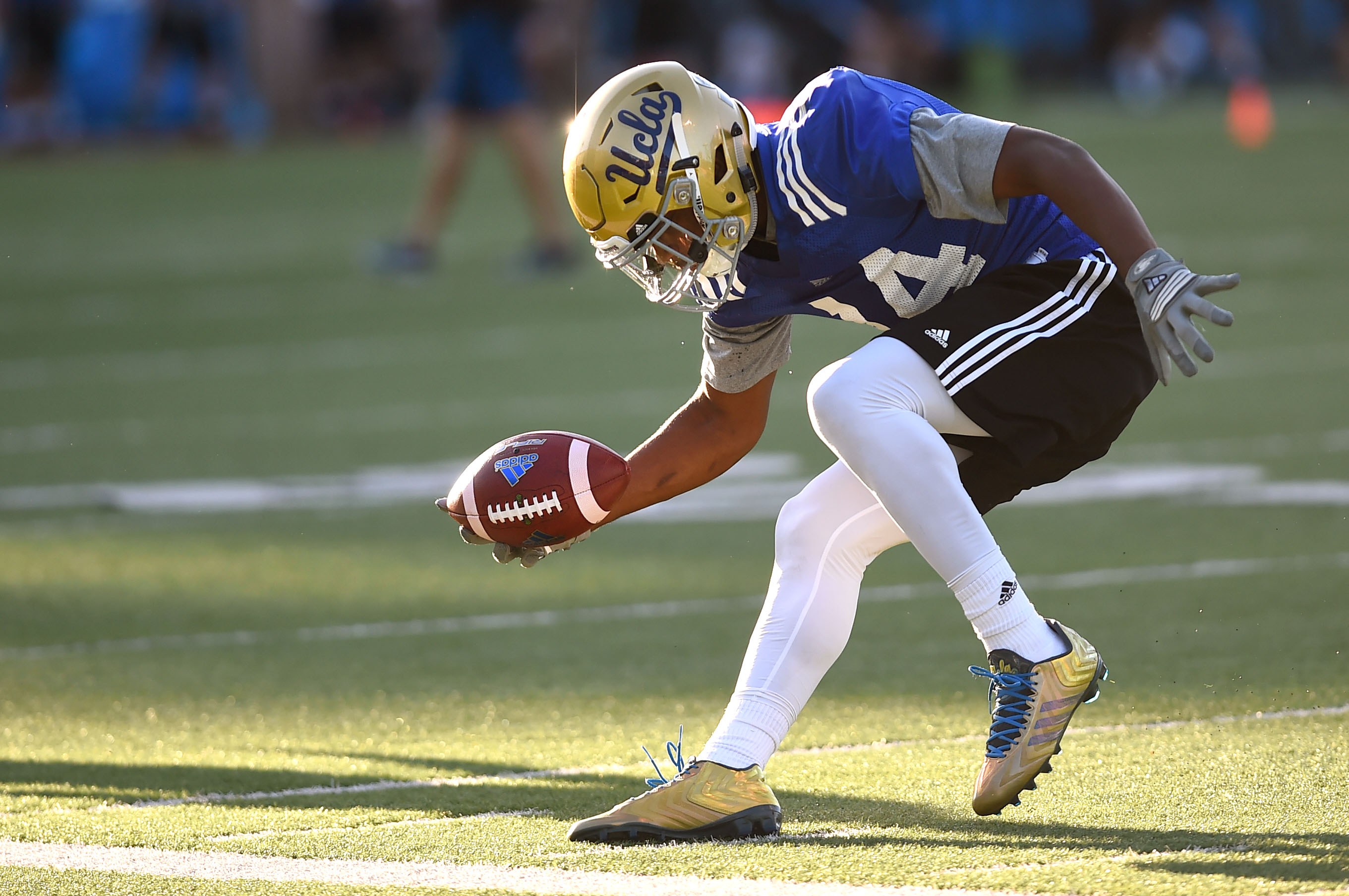 UCLA's Mossi Johnson catches a pass during spring football practice on April 2 at Spaulding Field.(Andy Holzman/Staff)