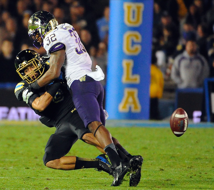 Washington Huskies defensive back Tre Watson (32) knocks away pass intended for wide receiver Jalen Ortiz (8) during the the Bruins' 41-31 win at the Rose Bowl on Nov. 15, 2013. Ortiz switched to cornerback the following season. (Keith Birmingham/Staff)