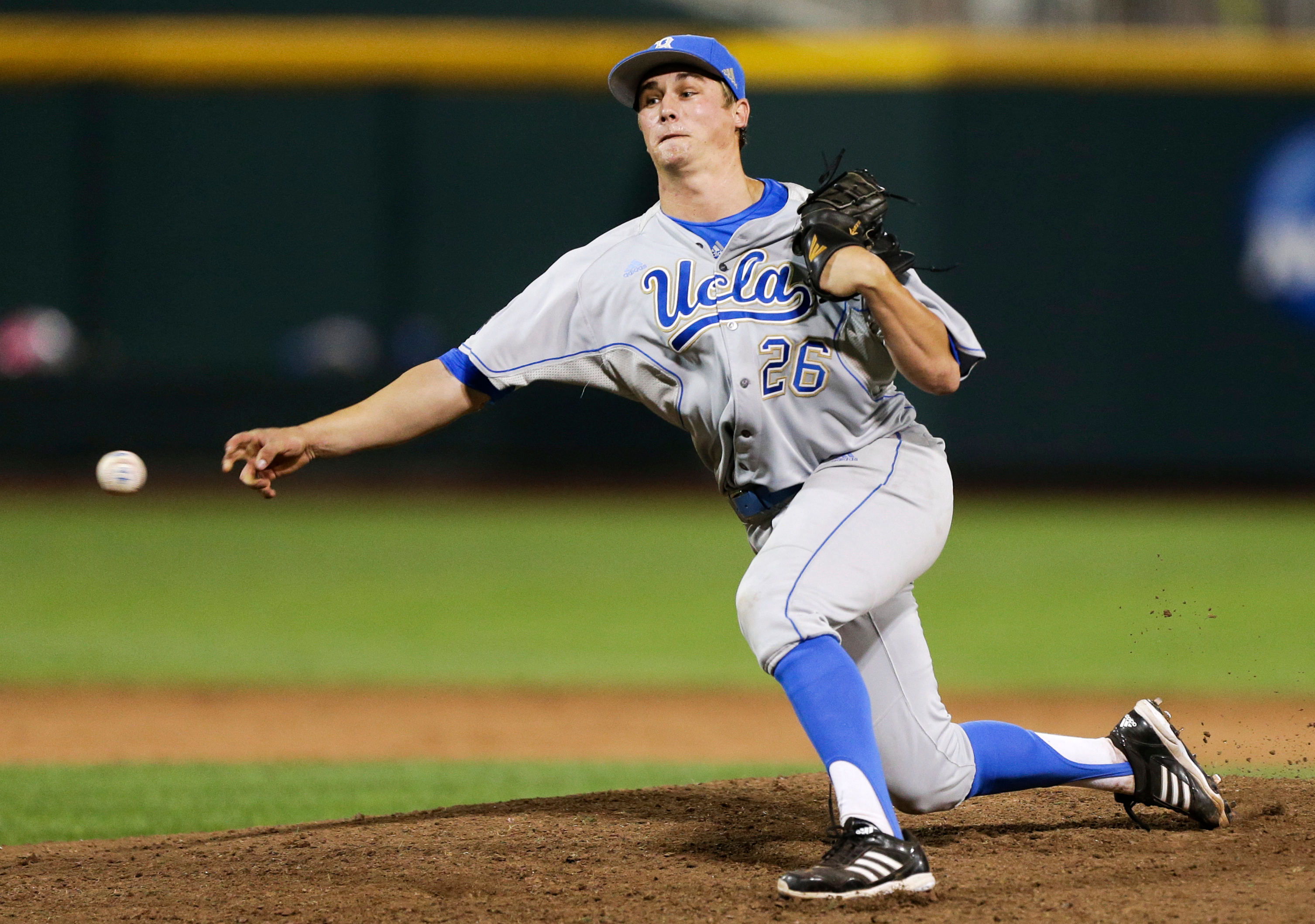 UCLA closer David Berg delivers against Mississippi State in the ninth inning of Game 1 of the College World Series on June 24, 2013. Berg earned his 24th save, setting a new NCAA single-season record. (Nati Harnik/AP)