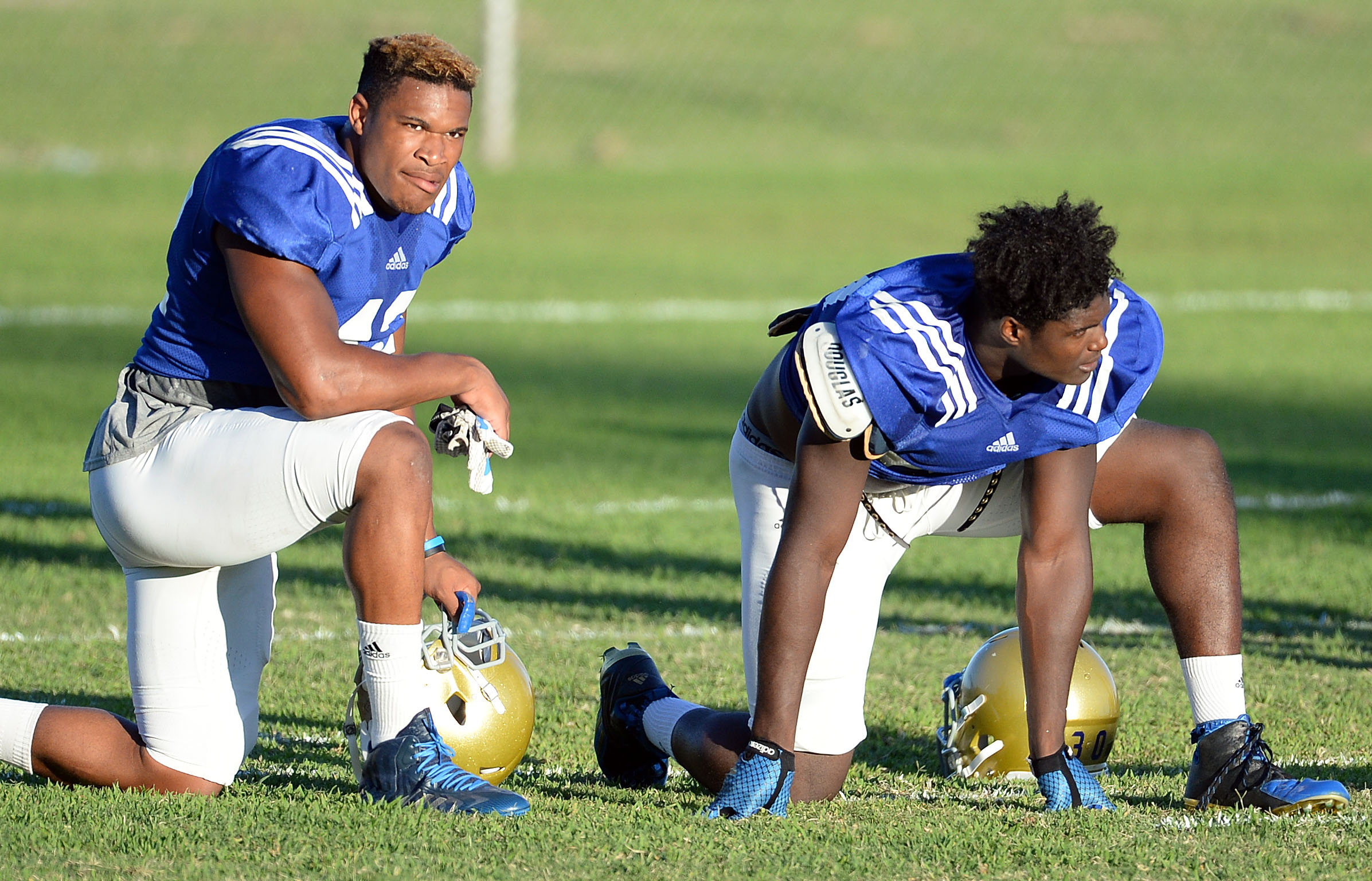 UCLA linebacker Kenny Young (left) has joined the Bruins' long line of injured players. (Will Lester/Staff )