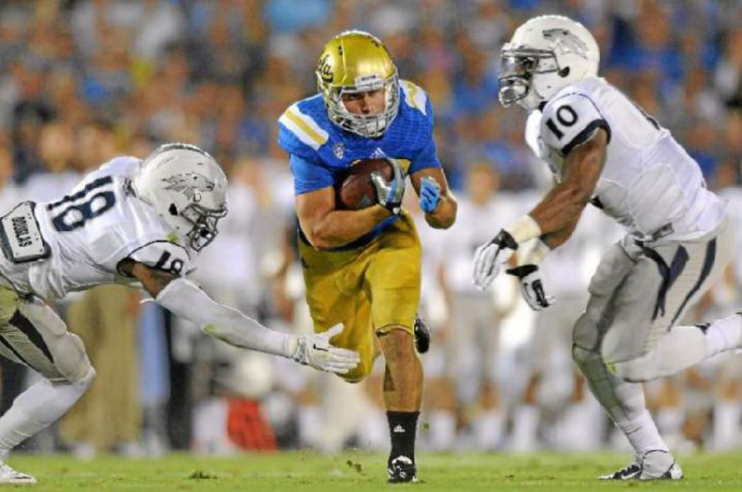 UCLA running back Steven Manfro (center) has been forced to retire from football due to multiple shoulder surgeries. (Keith Birmingham // Pasadena Star-News)