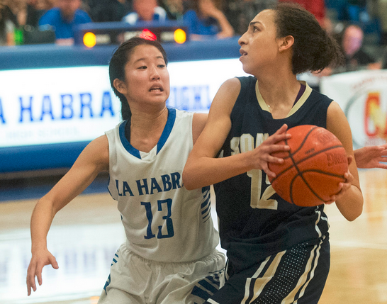 Sonora's Meghann Henderson (12) drives past La Habra's Lani Maehara (13) in their Freeway League girls basketball game at La Habra High School in La Habra on Wednesday January 28, 2015. (Photo by Keith Durflinger/Whittier Daily News)
