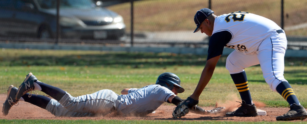 Montebello's Adam Rubio (7) dives back into first base ahead of the tag by Alhambra first baseman Vance Tovalin (26) in the third inning of a prep baseball game at Alhambra High School in Alhambra, Calif., Tuesday, April 28, 2015. Montebello won 3-2. (Photo by Keith Birmingham/ Pasadena Star-News)