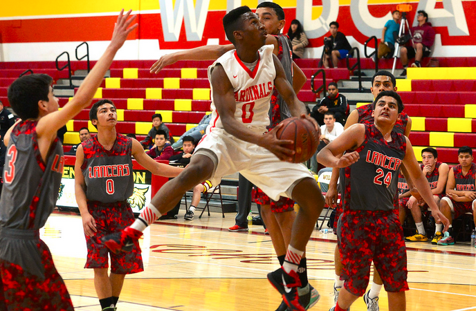 Whittier's Malik Pittman (0) drives to the basket against Bell Gardens in the first half of a prep basketball game at Wilson High School in Hacienda Heights, Calif., on Tuesday, Dec. 29, 2015. (Photo by Keith Birmingham/ Pasadena Star-News)
