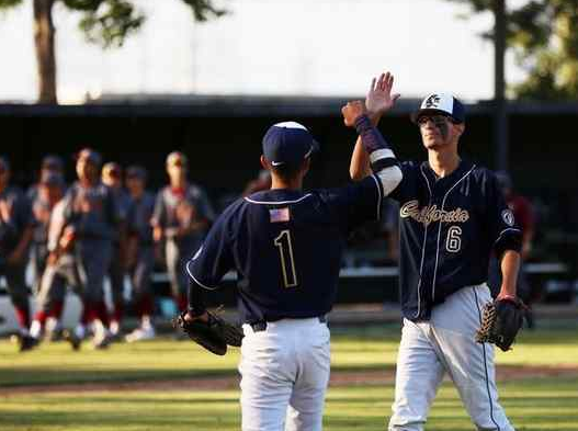 California's Landon Soto (1) and Jakob Farmer (6) celebrate after defeating La Serna 4-2 in a rivalry prep baseball game at Rio Hondo College in Whitter, Calif. on Friday, April 1, 2016. (Correspondent photo by Trevor Stamp)